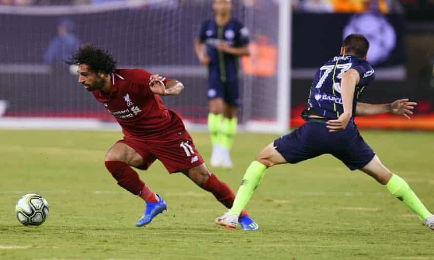 Mohamed Salah skips past Manchester City's Benjamin Garre.