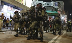 Riot police clash with protesters on the street of Yuen Long, Hong Kong on 21 October.