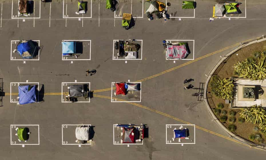 Rectangles designed to help prevent the spread of the coronavirus by encouraging social distancing are drawn in a city-sanctioned homeless encampment in San Francisco in May.