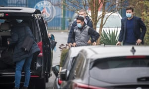 Mauricio Pochettino (right) and assistant Jesus Pérez (centre) arrive at the PSG offices.