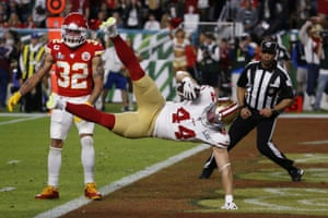 San Francisco 49ers' Kyle Juszczyk falls into the end zone for a touchdown during the first half.