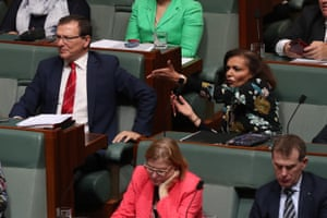Anne Aly reacts to the prime minister during question time.