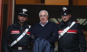 CORRECTS FIRST NAME TO SETTIMO, NOT SETTIMINO - Settimino Mineo, center, who allegedly took over as the Palermo head of Cosa Nostra, is escorted by Italian Carabinieri police after an anti Mafia operation which led the arrest of 46 people including the presumed regional boss, in Palermo, Sicily, Italy, Tuesday, Dec. 4, 2018.  Italian police say they have dismantled the rebuilt upper echelons of the Sicilian Mafia. (Igor Petyx/ANSA via AP)