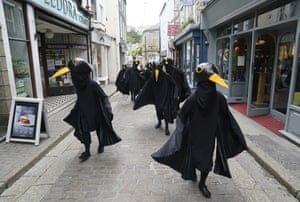Members of Extinction Rebellion dressed as birds protest in St. Ives