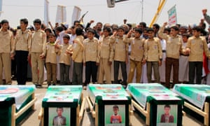 Yemeni children vent anger against Riyadh and Washington as they take part in a mass funeral for the 40 children killed in an air strike by the Saudi-led coalition last week.