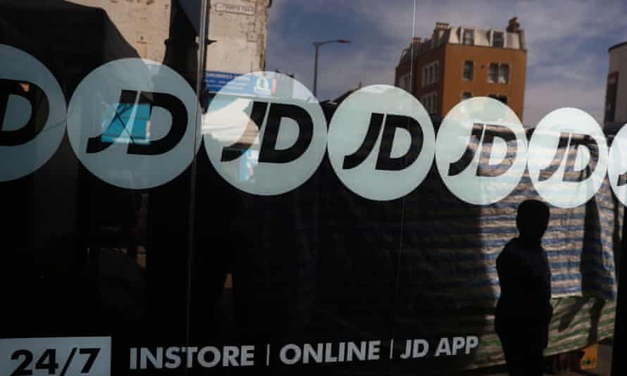 People pass a JD Sports store
