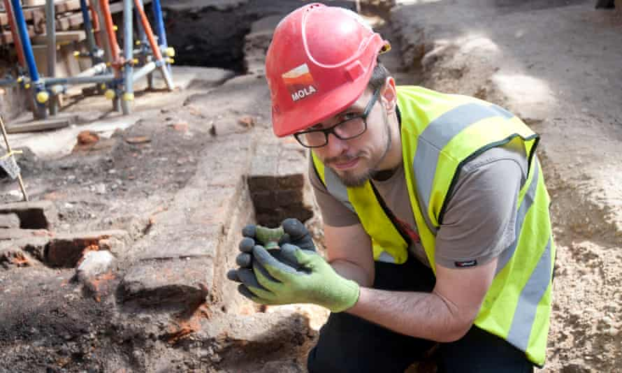 Archaeologist Paul McGarrity holds a 16th-century bird whistle, a possible theatrical sound effect, discovered at the Curtain.