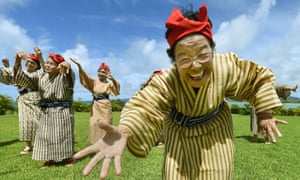 An elderly women band of singers and dancers from Kohama Island in Okinawa wearing traditional local costumes perform at a herb garden on Kohama Island, Okinawa Prefecture. The band has an average age of 84.