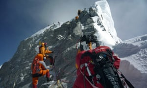 A group of climbers approach the Hillary Step near the summit of Everest.