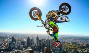 Freestyle trials rider Jack Field of Australia performs the highest backflip on a motorcycle ever recorded, above the roof of Melbourne's Eureka Tower