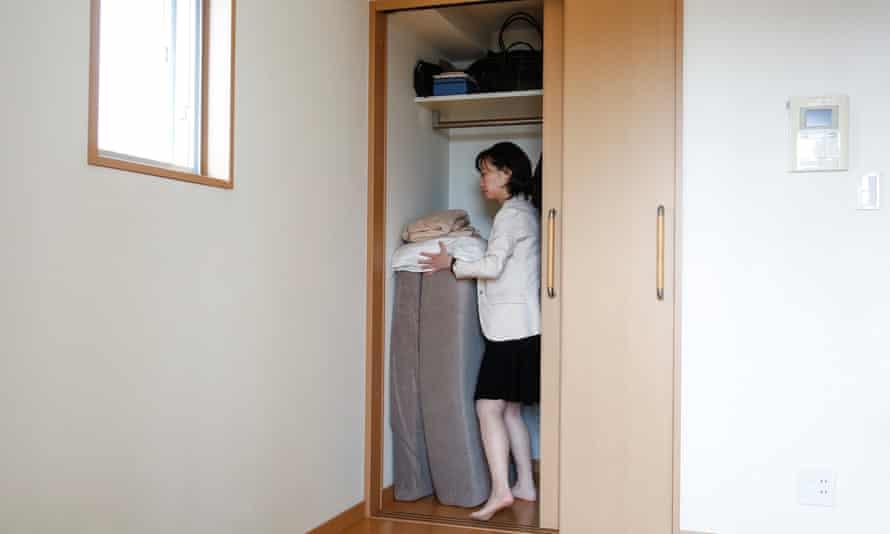 Minimalist Saeko Kushibiki stores away her futon mattress in her apartment in Fujisawa.