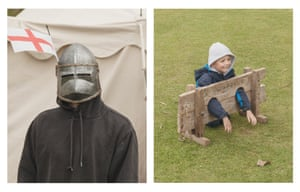A teenager wears a knight's helmet adorned with the St George's Cross, and a boy poses with his arms in a set of stocks