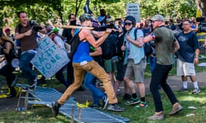 White supremacist groups clash with counter-protesters on 12 August 2017 in Charlottesville, Virginia.