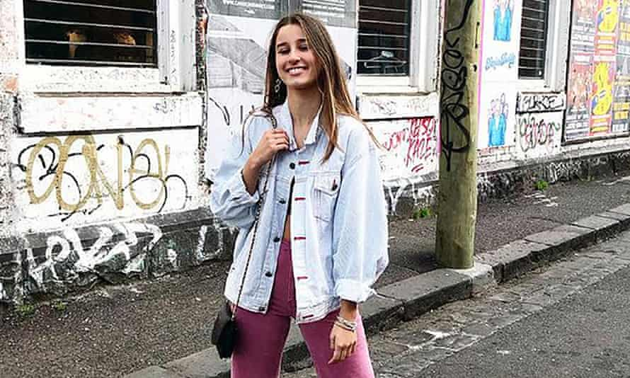 long haired girl in faded denim jacket and pink pants