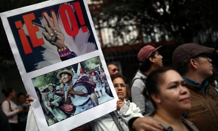 People take part in a demonstration in support of Bolivian President Evo Morales after he announced his resignation on Sunday