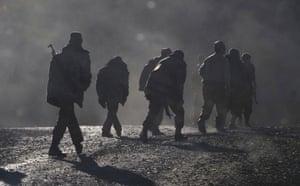 Ethnic Armenian soldiers walk along the road near the border between Nagorno-Karabakh and Armenia.