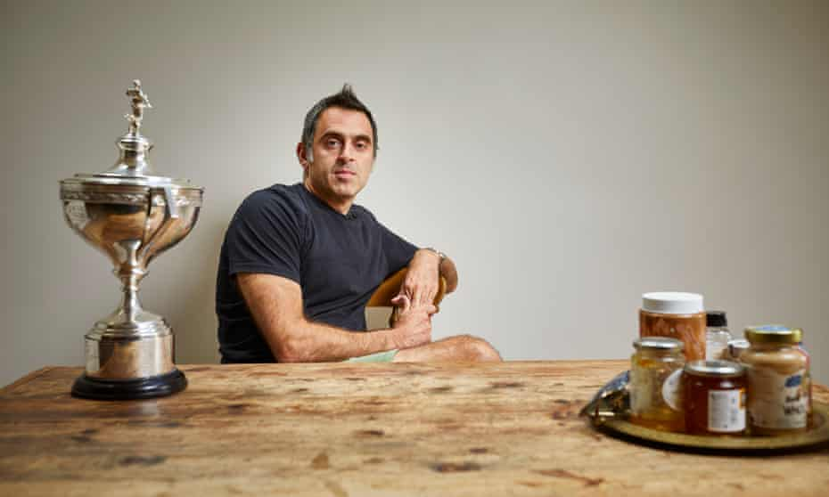 Ronnie O'Sullivan at home, with his trophy for winning this year's World Snooker Championship.