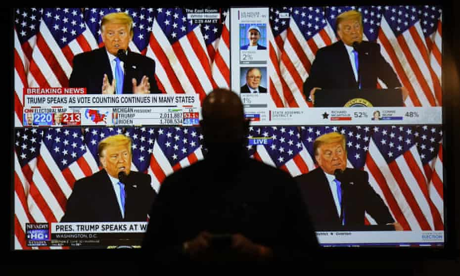 A live broadcast of Donald Trump speaking from the White House is shown on screens at an election night party in Las Vegas on 3 November.