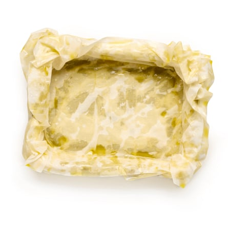 Line a baking pan with half the filo: brush each sheet with oil and layer up.