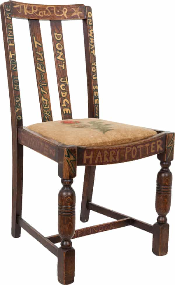 """Before she first put the chair up for chairty auction in 2002, Rowling """"refurbished"""" it with Potter-themed inscriptions."""
