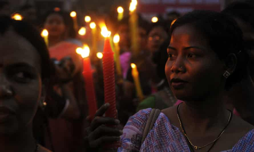 Indian sex workers and supporters march in a candle-lit procession in Kolkata