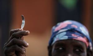 A woman in north-east Uganda shows a homemade tool used for female genital mutilation