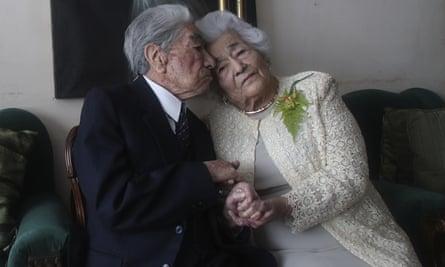 Julio Mora and Waldramina Quinteros pose for a photo at their home in Quito, Ecuador, on 28 August.