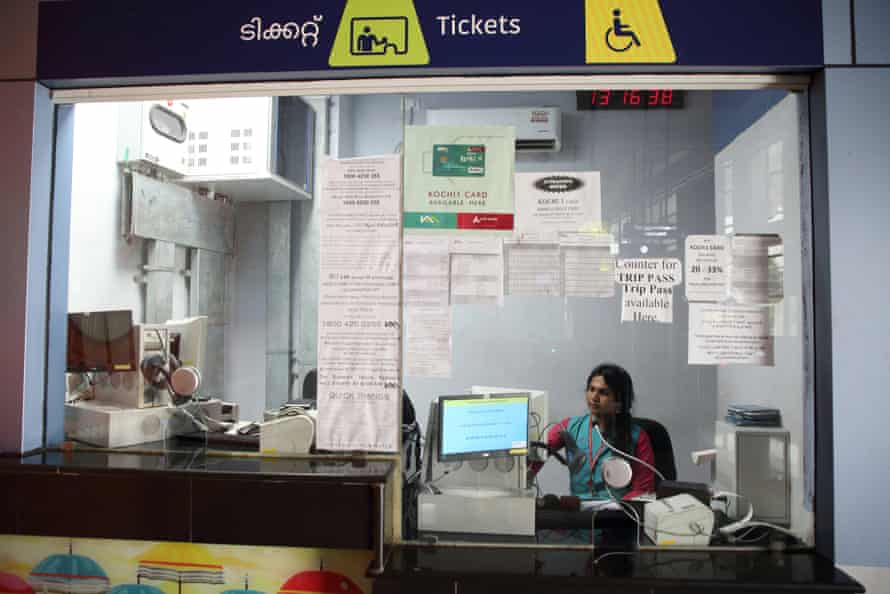 Karthika sits at a ticket counter at Changampuzha Park station in Kochi