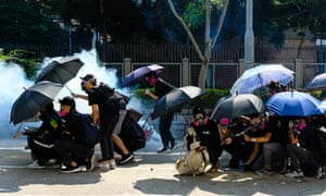 Riot police fire tear gas at the protesters during a protest in Jordan district of Hong Kong