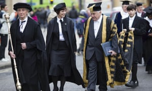 The chancellor and new vice-chancellor process along Broad Street, Oxford.