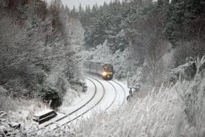 The Inverness to Edinburgh train battles through snow at Culloden, near Inverness