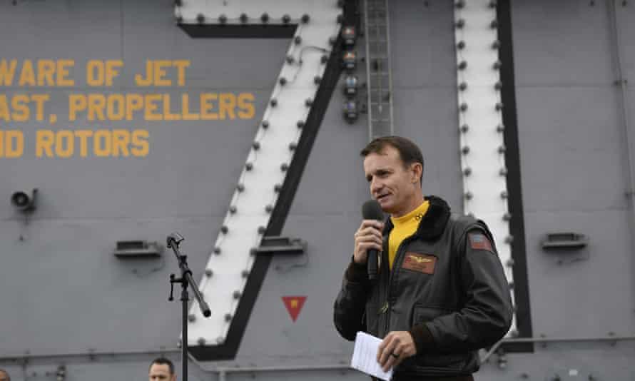 Capt Brett Crozier addresses the crew of the USS Theodore Roosevelt.