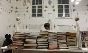 Benyamin Badalov, 15, reads the evening prayer on the first night of Hanukah at the main synagogue in Bukhara.