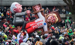 A float featuring an effigy of Jarosław Kaczyński, leader of Poland's ruling Law and Justice party, overpowering 'the liberal Poland', at a parade in Düsseldorf, Germany in March this year.