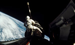 Richard Gordon undertaking a space walk during the Gemini 11 mission, attaching a tether from the Gemini capsule to the Agena vehicle at around 160 nautical miles above Earth, 1966.