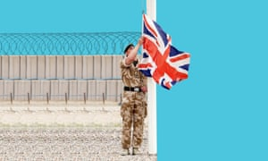 A British army corporal lowers the union flag during a 2007 ceremony to mark the transfer of control of a military base in Basra.