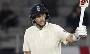 England's Joe Root signals his 50 against New Zealand during the first Test match in Auckland.