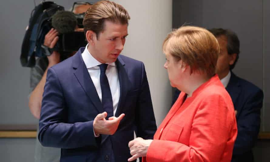 The German chancellor, Angela Merkel, talks to the Austrian prime minister, Sebastian Kurz, during the summit in Brussels.
