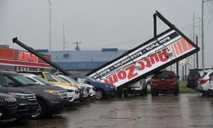 High winds toppled a large store sign on Devereux Drive in Natchez, Miss.