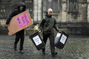 Election workers deliver ballot boxes on the Royal Mile in Edinburgh, Scotland