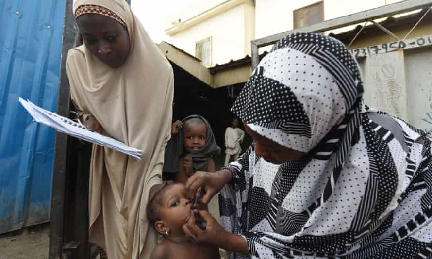 A health worker immunises a child during a vaccination campaign in north-west Nigeria