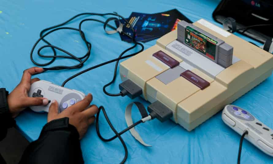 A child playing Donkey Kong Country on the American version of the Super Nintendo Entertainment System.