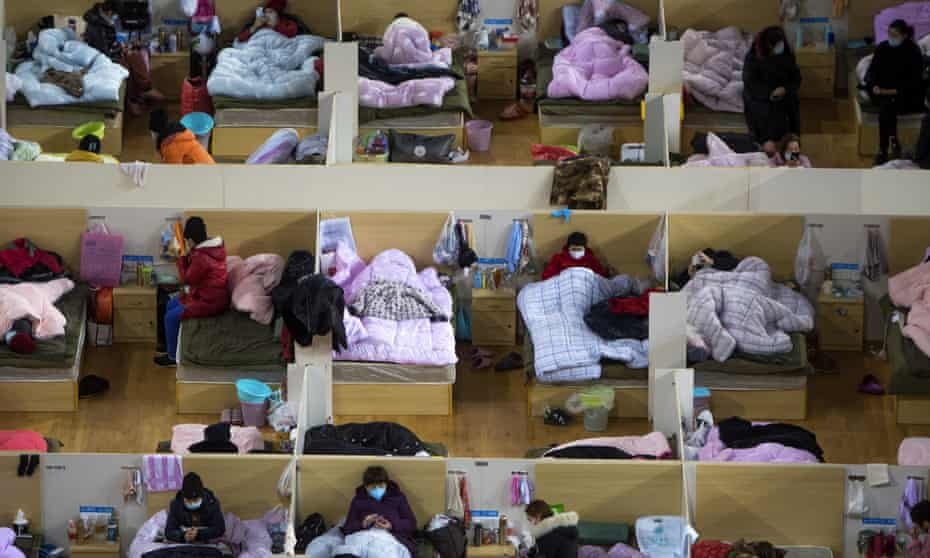 Coronavirus patients in a temporary hospital converted from a sports centre in Wuhan in February.