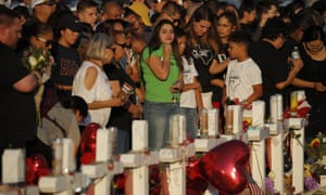 People visit a makeshift memorial in El Paso on 6 August.