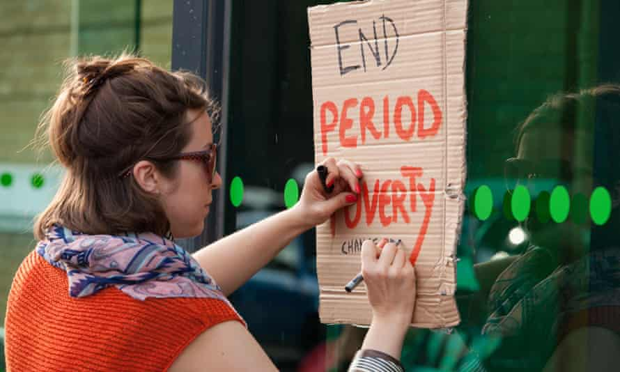 A campaigner outside a supermarket in East London calls for a reduction in prices to offset the 'tampon tax'.