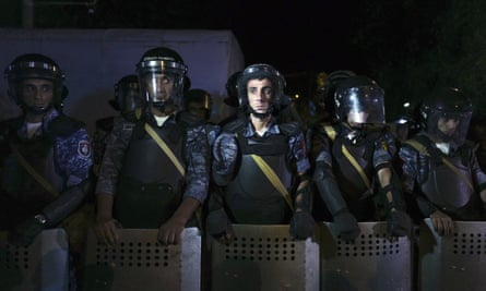 Riot police secure a police station held by an armed group in Yerevan, Armenia, on 27 July.