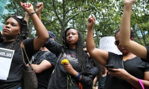 Protesters hold their fists in the air during a Black Lives Matter demonstration in New York on 10 July 2016.