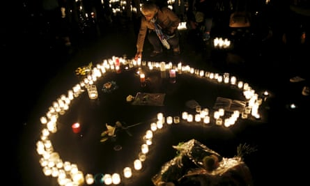 People light candles to pay tribute to the victims of the Paris attacks.