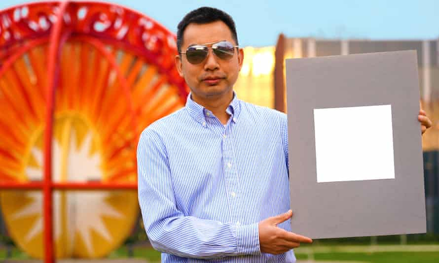 Prof Xiulin Ruan, a professor of mechanical engineering, with a sample of the paint.