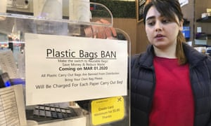 A notice at a New York checkout about the plastic bag ban in place from 1 March